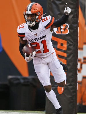 Browns cornerback Denzel Ward celebrates after an interception during the second half of a game against the Cincinnati Bengals last season.