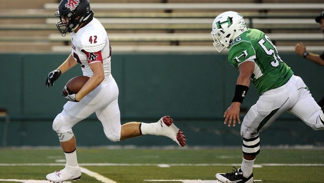 Thomas Metthe/Reporter-News Anson tight end Chris Jones (42) sprints past Hamlin defensive lineman Shawn Montanez (56) for a touchdown in the second quarter of Anson's 46-16 win in the Action Zone Champions Classic on Thursday, Aug. 25, 2016, at Shotwell Stadium in Abilene.