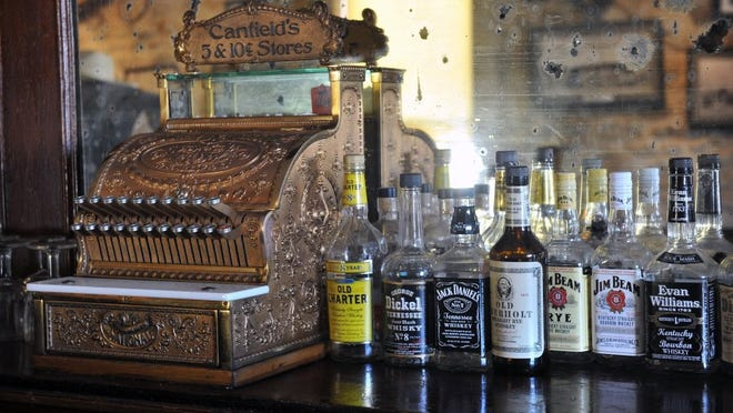 TORIN HALSEY/TIMES RECORD NEWS A vintage cash register and bottles of liquor at the Stonewall Saloon Museum in Saint Jo hearken back to its original role as a rest stop for settlers and cowboys on the Chisholm Trail. The museum features a wide variety of historical artifacts from the early days of Montague County.