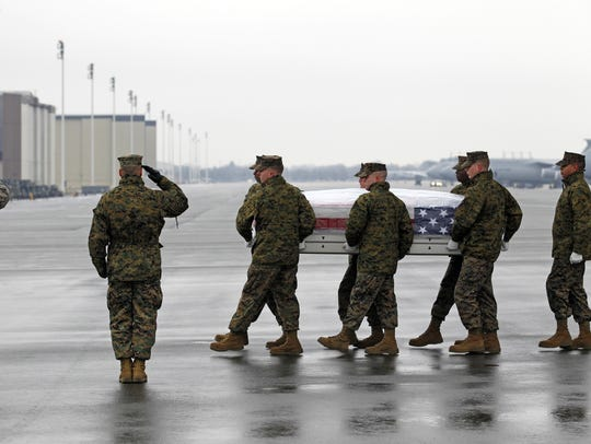 U.S. Marines carry the remains of Marine Cpl. Phillip