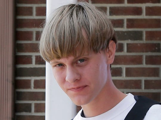 Shooting suspect Dylann Storm Roof is escorted from