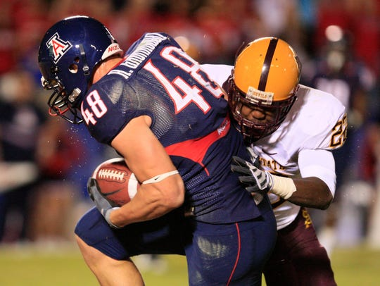 Arizona's Rob Gronkowski, left, scores a touchdown against Arizona State in Tucson Dec. 6, 2008.