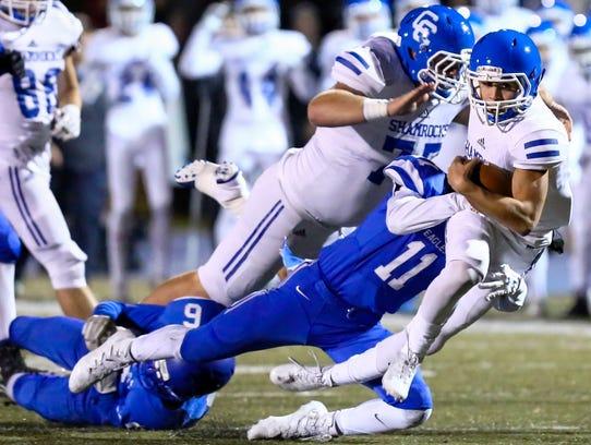 Catholic Central quarterback Marco Genrich stretches
