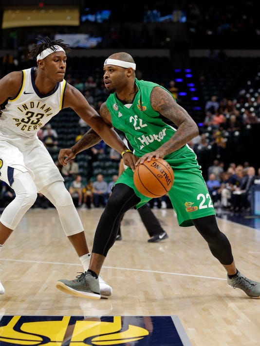 Maccabi Haifa's Will Graves (22) drives on Indiana Pacers forward Myles Turner (33) during the first half of an NBA exhibition basketball game in Indianapolis, Tuesday, Oct. 10, 2017. (AP Photo/Michael Conroy)