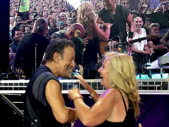 Wilmington's Donna Smits with musician Bruce Springsteen.
