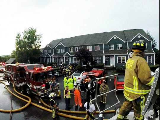 Firefighters from Brewster and surrounding departments responded to a blaze at the complex that was caused by a lightning strike around 6 p.m. at the Fieldstone Pond condominium Wednesday, July 2.