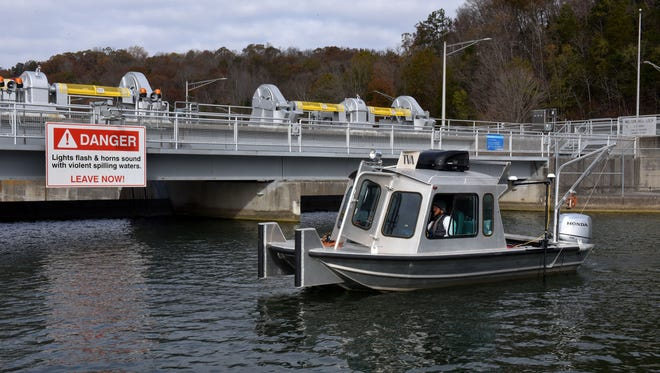 TVA Dam Safety engineer Benjamin Phillips with Mike Richardson guiding the boat use new 3D scanning sonar technology to perform a dam inspection at Melton Hill Dam Tuesday, Nov. 14, 2017.