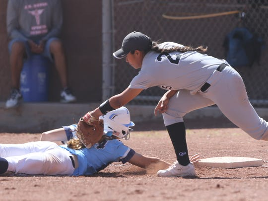 Hanks first baseman Bryanna Molina tags Chapin baserunner Kristin Fifield on a pickoff attempt Saturday at Chapin. She was safe.