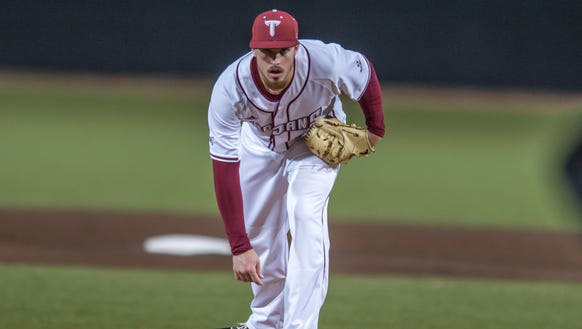 Troy senior pitcher Jeremy McGowan threw passes to