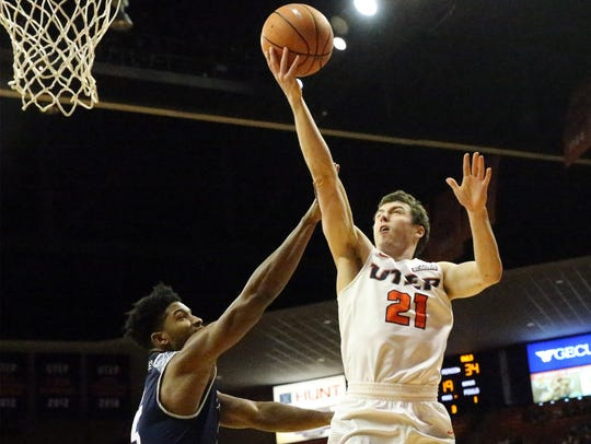 UTEP guard Trey Touchet, 21, drives for a layup against