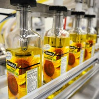 Tom Smude, Smude's Sunflower Oil, fills bottles of oil May 15 in Pierz.