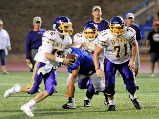 Connor Carlton, right, returns to anchor the Wylie