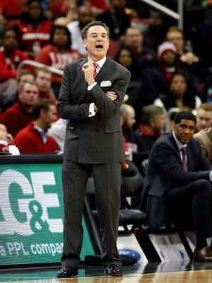 Louisville's Rick Pitino shouts some instructions from the sideline. Jan. 13, 2015