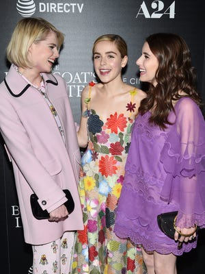 """FILE - In this March 22, 2017 file photo, actors Lucy Boynton, left, Kiernan Shipka and Emma Roberts attend a special screening of """"The Blackcoat's Daughter"""", hosted by A24 and DirecTV, at Landmark Sunshine Cinema in New York.  Oz Perkins', whose father Anthony Perkins starred in """"Psycho,"""" is making his directorial debut this spring with the psychological thriller """"The Blackcoat's Daughter."""" He said he was inspired by the strange glamour of the classic film """"Rosemary's Baby.""""(Photo by Evan Agostini/Invision/AP)"""