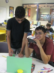 David, 13, and Rafael Medina, 18, work on their stop-motion