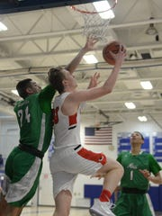 Canton's Meredith Chase drives to the basket against Novi's Tariq Woody.