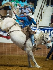 Ross Griffin in sadle bronc during the SLE Rodeo matinee