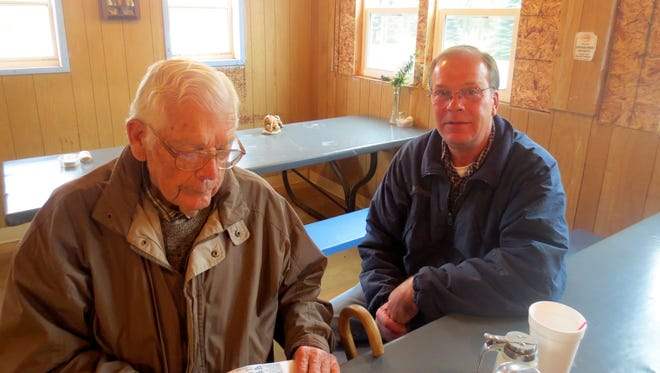 John Radford and Jimmy O'Connor talk over coffee in the restaurant at the Croswell Stock Yards.