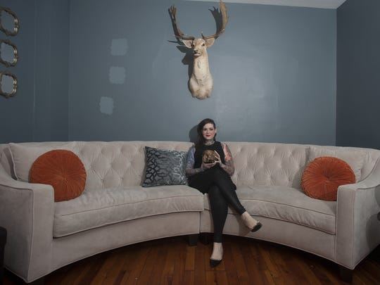 Nicole Angemi poses for a photo holding a human skull at her home in Merchantville. Angel, is an Instagram star: more than 738,000 followers see her photos from autopsies, medical exams and emergencies. But it's not just about shock value. The Merchantville woman, a pathologist's assistant, is hoping to educate followers on health, death and anatomy.