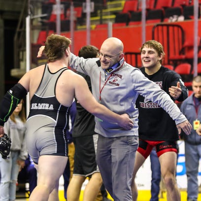 Watkins Glen's Brandon Gould with his first-place medal after capturing the Division II 132-pound title Saturday night.