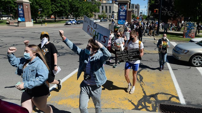 Participants in the No Pride Without Black Lives rally march north on State Street from Perry Square on Saturday.