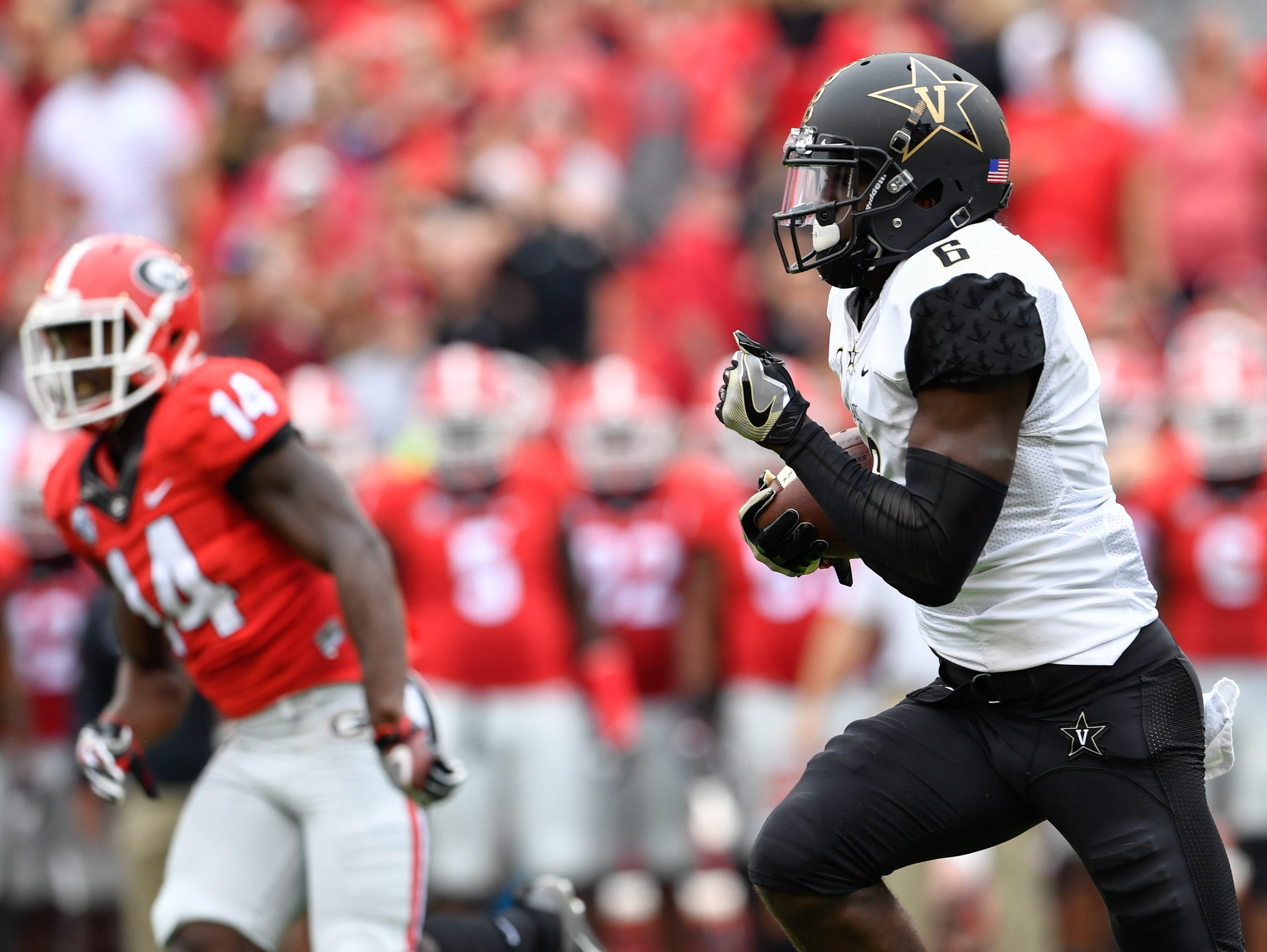 Vanderbilt's Darrius Sims (6) returns the opening kickoff 95 yards against Georgia last season.