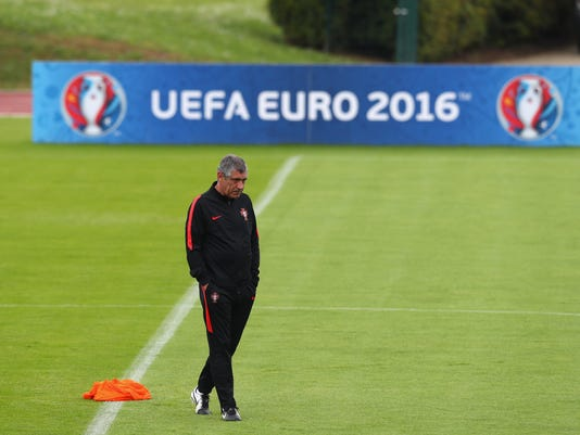 Portugal coach Fernando Santos walks on the pitch during a training session in Marcoussis, near Paris, France, Monday, July 4, 2016. Portugal will face Wales in a Euro 2016 semi final soccer match in Lyon on Wednesday, July 6, 2016. (AP Photo/Thibault Camus)