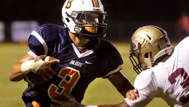 Blackman's Taeler Dowdy (3) runs the ball as Tucker's Jeremiah Shelley (3)moves in for the tackle at Blackman, on Friday Sept. 11, 2015.