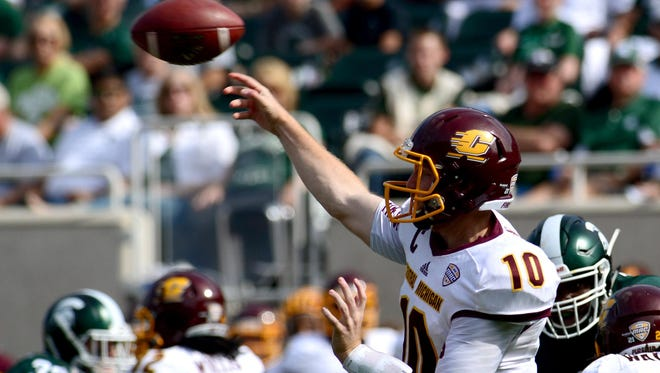 CMU quarterback Cooper Rush gets a pass off in the first quarter Saturday at Spartan Stadium. Rush, a 2012 Lansing Central Catholic High graduate, finished 26 of 39 for 285 yards and a touchdown.