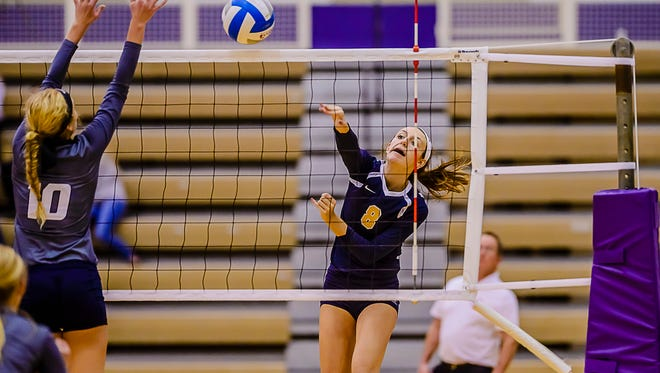 Haslett's Lily Metcalf ranks among the area's leaders in kills and blocks per set.