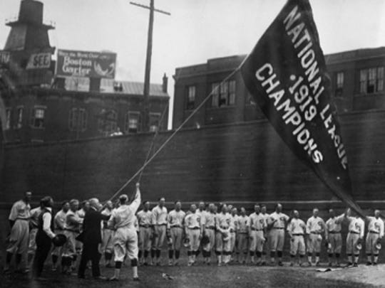 "Early in the 1920 season, the Reds players hoisted their ""Cincinnati Reds - 1919 - Champions of the World"" banner at Redland Field. By September of that year, a new baseball commissioner, Kenewsaw Mountain Landis, banned eight White Sox players from organized baseball for life. The ""Eight Men Out"" - including the great slugger, Joe Jackson, who received $5,000 to throw the Series - never again played organized ball."