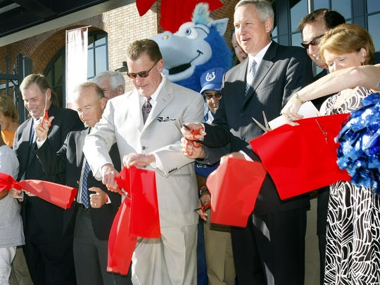 Jim Irsay (center) cutting the ribbon to open Lucas Oil Stadium, Aug. 16, 2008.