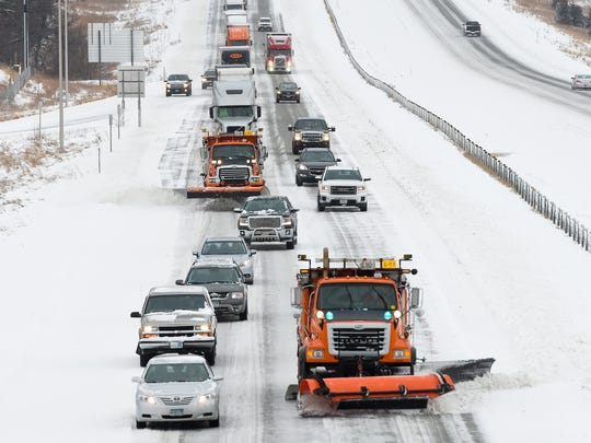 Snowplows from the Minnesota Department of Transportation clear snow Monday, March 5, off Interstate 94 near Opportunity Drive. The state Department of Transportation estimates it will spend $302 million on salaries in 2018.