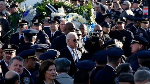 U.S. Vice President Joe Biden, center, arrives for funeral services for New York City police officer Rafael Ramos at Christ Tabernacle Church, in the Glendale section of Queens Saturday.