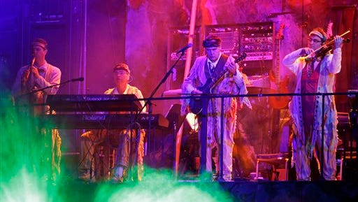 """In this photo, Bruce Rickerd, second from from right, performs in the show """"Mystere"""" in Las Vegas. On Dec. 27, a Guinness Book of World Records judge was expected to say Rickerd has broken the record from most theatrical performances by a male musician."""