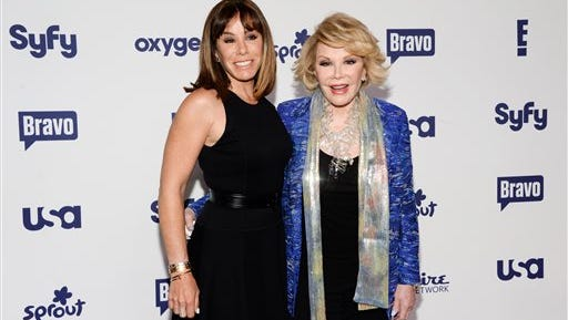 In this file photo, Melissa Rivers, left, and Joan Rivers attend the NBCUniversal Cable Entertainment 2014 Upfront at the Javits Center in New York. Melissa Rivers filed a malpractice lawsuit Monday, against doctors and the clinic where her mother Joan Rivers had a routine medical procedure, stopped breathing, and later died. Rivers said in a statement that filing the suit was one of the most difficult decisions she had to make.
