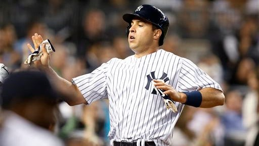 New York Yankees' Mark Teixeira returns to the dugout after scoring on Chase Headley's sacrifice fly in the fifth inning during a baseball game against the Kansas City Royals at Yankee Stadium in New York, Tuesday, May 26, 2015. The Yankees won 5-1. (AP Photo/Kathy Willens)