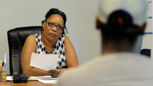 In a June 18, 2016, photo, Virginia Stephens, left, who is a home buyer counselor at Detroit Non-Profit Housing Corp., talks to a woman about what she needs to buy her first home, in Detroit. It and other nonprofits are the final options for hundreds of Detroit residents fighting foreclosures, auctions and evictions.  (AP Photo/Jose Juarez)