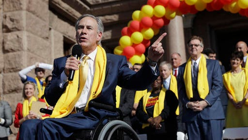 Gov. Greg Abbott speaks during a rally in support of school choice on the steps of the Texas Capitol on Tuesday in Austin. Lt. Gov. Dan Patrick is behind him.