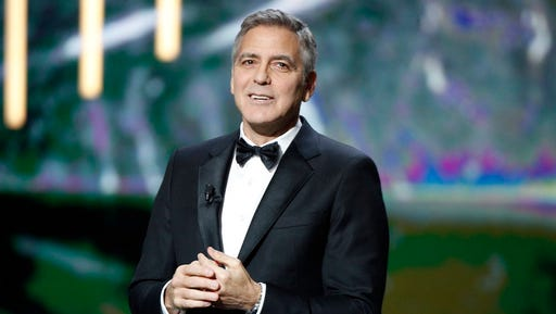 Actor George Clooney reacts on stage as he received an Honorary Cesar award during the 42nd Cesar Film Awards ceremony at Salle Pleyel in Paris, Friday, Feb. 24, 2017. This annual ceremony is presented by the French Academy of Cinema Arts and Techniques.