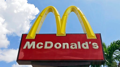 """FILE - This Tuesday, June 28, 2016, file photo shows a McDonald's sign at one of the company's restaurants in Miami. On Thursday, March 16, 2017, McDonald's said it has been notified by Twitter that its account was """"compromised"""" after it appeared to send a message calling Donald Trump """"a disgusting excuse of a President."""""""