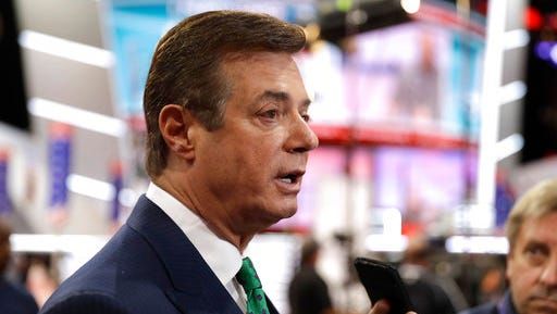 FILE  - In this July 17, 2016, file photo, then-Trump campaign chairman Paul Manafort talks to reporters on the floor of the Republican National Convention in Cleveland. U.S. Treasury Department agents have recently obtained information about offshore financial transactions involving Manafort, as part of a federal anti-corruption probe into his work in Eastern Europe, The Associated Press has learned.