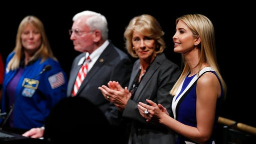 """From right, Ivanka Trump, Education Secretary Betsy DeVos, John R. """"Jack"""" Dailey, director of the National Air and Space Museum and NASA Astronaut Kay Hire, applaud at the Smithsonian's National Air and Space Museum in Washington, Tuesday, March 28, 2017, during an event to celebrate Women's History Month."""