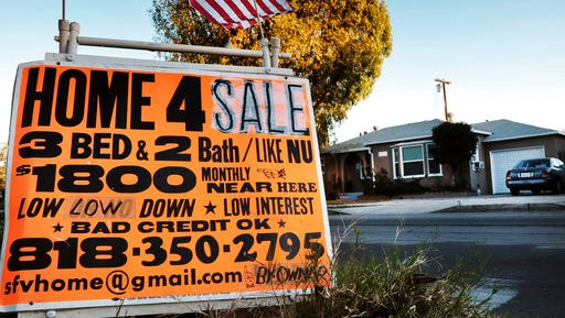 FILE - This Saturday, Jan. 17, 2015, file photo shows a sign advertising a house for sale in Los Angeles. U.S. home prices jumped in January 2017 from a year earlier at the fastest pace in nearly 2 1/2 years, as a tight supply of houses for sale spurred bidding wars in many cities. The Standard & Poor's CoreLogic Case-Shiller 20-city home price index, released Tuesday, March 28, 2017, increased 5.7 percent in January, the most since July 2014.