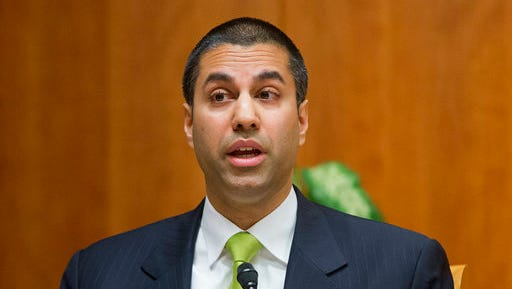 """FILE - In this Feb. 26, 2015, file photo, Federal Communication Commission Commissioner Ajit Pai speaks during an open hearing and vote on """"Net Neutrality"""" in Washington. Tech companies are readying for a showdown with a Republican-controlled government over threats to net neutrality, a key issue for them and their users."""