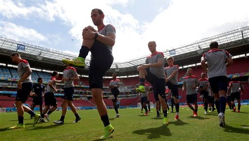 United States' Brad Davis, center left, and Michael Bradley, center, work out with teammates during a training session in Recife, Brazil, Wednesday, June 25, 2014. The U.S. will play Germany in group G of the 2014 soccer World Cup on June 26. (AP Photo/Julio Cortez)