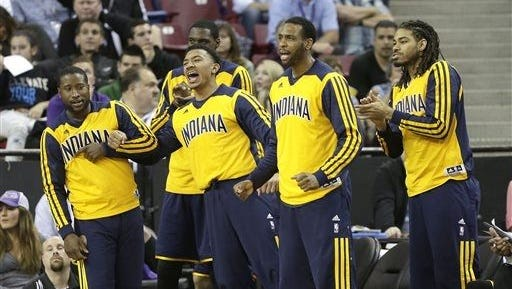 The Pacers' bench celebrates big efforts from the starters on Friday night
