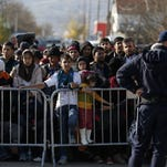 File photo shows Syrian refugees in Serbia. Several U.S. governors are threatening to halt efforts to allow Syrian refugees into their states in the aftermath of the terrorist attacks in Paris, and at least one is asking the White House for more information on plans to allow refugees into the country.