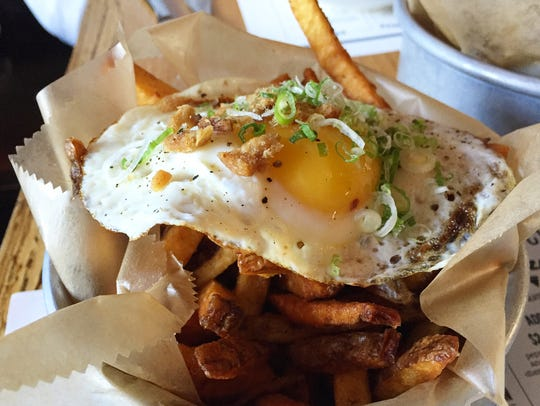 Fries with bacon salt and a fried egg at Polpettina