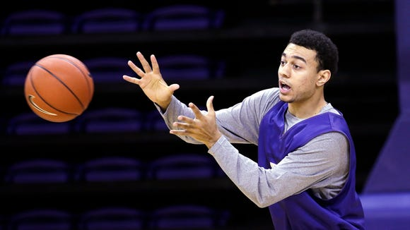 Washington's Nigel Williams-Goss reaches for a pass during basketball practice Tuesday, Oct. 8, 2013, in Seattle.